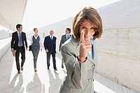 Spain, Mallorca, Businesswoman gesturing, Business people in background
