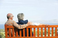 Spain, Mallorca, Senior couple sitting on bench, rear view