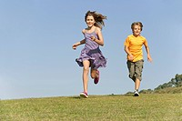 Boy 8_9 and girl 10_11 running together