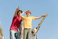Spain, Mallorca, Father and son standing on tree