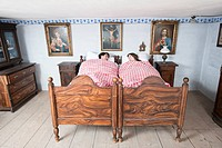 Germany, Bavaria, Young couple lying in bedroom