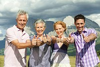Italy, Seiseralm, Four persons, thumbs up, smiling, portrait, close_up