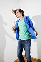 Germany, Berlin, Young man dancing, portrait
