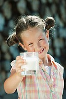 Italy, South Tyrol, Girl 6_7 holding a glass of milk, smiling, portrait, close_up