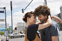 Germany, Berlin, Young couple embracing, laughing, portrait, close_up
