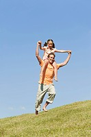 Italy, South Tyrol, Father carrying daughter 6_7 on his shoulder, laughing, portrait