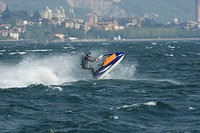 Italy, Lake Como, Man riding speedboat
