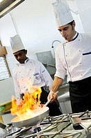 Flambe chef who cooks, frying pan blaze