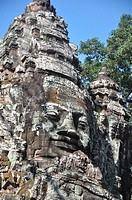 Angkor (Cambodia): statue on the top of the North Gate