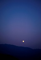 Moon with Silhouette of Montains
