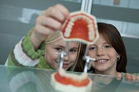 Germany, Bavaria, Landsberg, Two Girls 8_9 in dental surgery, portrait
