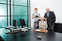 Germany, Munich, Business people in office, smiling, portrait