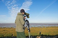 Bird watcher on Morecambe Bay