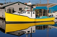 Yellow lobster boat at Fishermans Cove Eastern Passage Halifax Nova Scotia