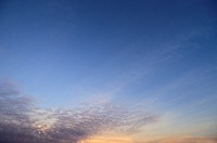 Thin Purple Clouds In A Blue And Orange Sunset Sky