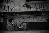 Bicycle and graffiti on wall