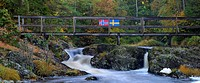 Scandinavia, Norway, Sweden, Bohuslan, View of flowing water with bridge