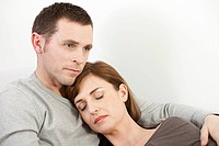 Sleeping woman resting on husband (thumbnail)