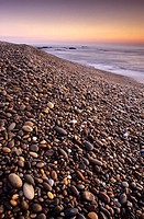 A beach of pebbles during sunset, Belinho beach, Parque Natural do Litoral Norte, Esposende, Minho, Portugal