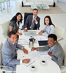 Multi_ethnic smiling business people working in a meeting