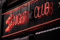 World Famous Night Club sign outside the Windmill International in Soho, London, England