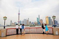 Pudong skyline from the Bund with people looking across