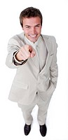Assertive attractive businessman pointing at the camera isolated on a white background