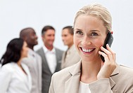 Beautiful blonde businesswoman on phone in workplace