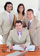 Assertive business people studying a document in a meeting