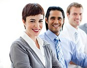 Multi_ethnic co_workers smiling at the camera in a meeting