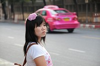 Young Thai Woman waiting for the Bus