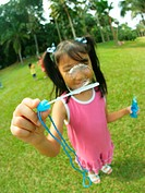 Close_up of a girl holding a bubble wand