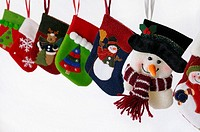 Collection of Christmas stockings with snowmen hanging on white background