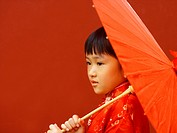 Close_up of a girl holding a parasol