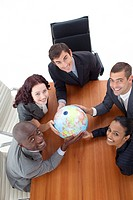High Angle of smiling team holding a globe in a meeting Global business