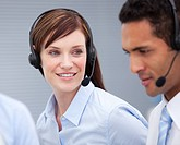 Close_up of a female customer service agent and her colleague in a company