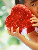 Portrait of a girl holding a heart shape box