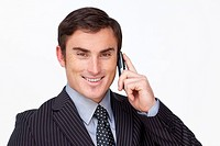 Portrait of an attractive young businessman on phone against white