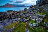 Scotland, Isle Of Skye, Elgol  Looking across the rocky shoreline north of Elgol towards the peaks of the Black Cuillins