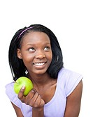 Cute young woman eating an apple against a white background