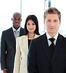 Young brunette businesswoman in focus with her team