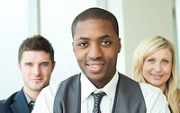 Portrait of an Afro_American businessman with his colleagues in folded arms