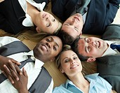 Closse_up of Business people lying in a circle on the floor of the office