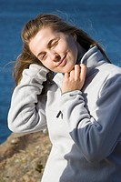 A girl in white fleece jacket looking at the sun