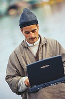 Kashmiri man using laptop , Jammu and Kashmir , India MR578
