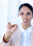Ethnic businesswoman holding a white card in office