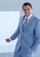 Young businessman pointing at a whiteboard in a presentation