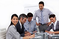 Confident young businessman presenting to his team in the office