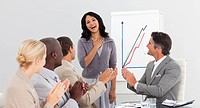 Young Business team in a meeting clapping at a presentation