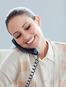 Assertive businesswoman talking on phone in the office